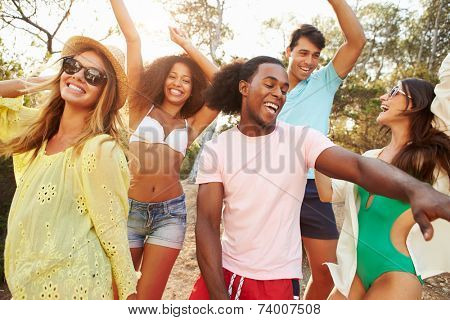 Group Of Young Friends Having Party On Beach Together