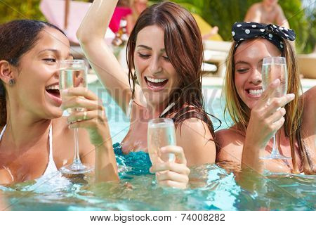 Three Women Having Party In Swimming Pool Drinking Champagne