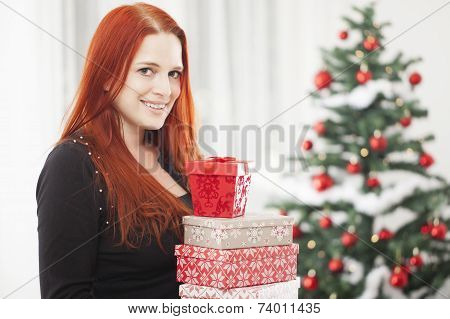 Girl Is Holding Christmas Present