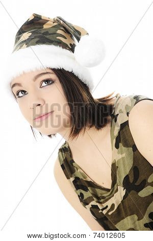 Close-up of a beautiful teen girl looking up.  She's dressed in a camouflage Santa hat and sleeveless shirt.  On a white background.