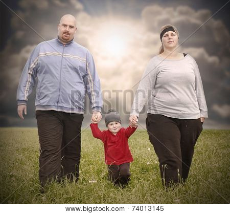 Overweight family together outdoor.