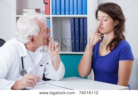 Physician Diagnosing Patient