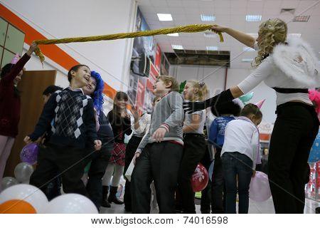 Nadym, Russia - November 30, 2012: School Children's Holiday. Unfamiliar Children With Their Parents