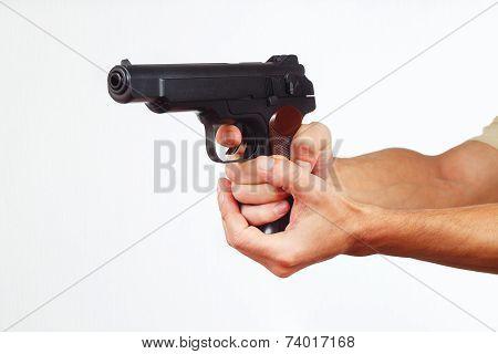 Hands with handgun on white background