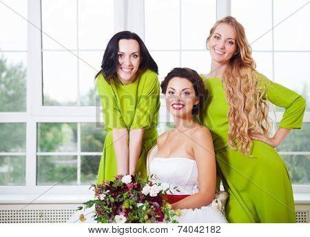 Cheerful Bride With Bridesmaid Holding Bouquet