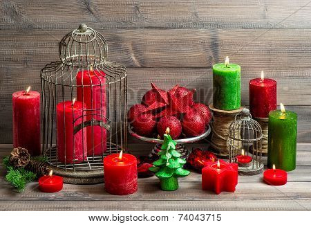 Vintage Christmas Background With Burning Candles And Red Baubles