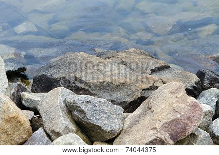 Granite Boulders Along The Lake Shoreline