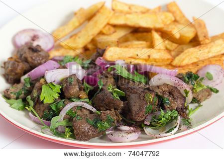 Albanian Liver, a traditional Turkish spiced lamb's liver recipe popular throughout the Middle East, with french fried chips