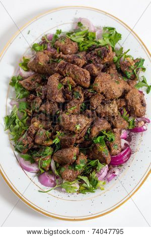 Albanian Liver, a traditional Turkish spiced lamb's liver recipe popular throughout the Middle East, high angle