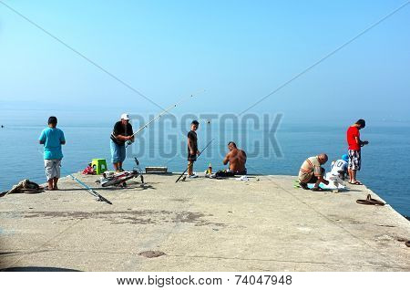 People angling on pier