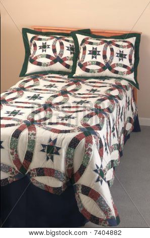 twin bed with quilt
