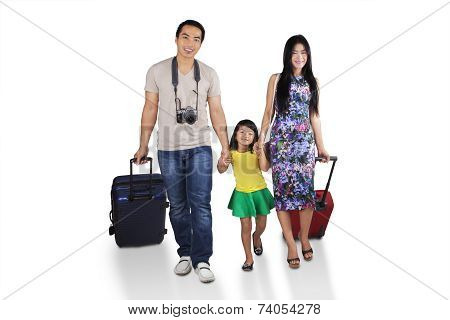 Cheerful Family Going To Holiday
