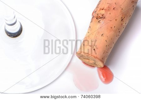 Red wine cork and a wineglass