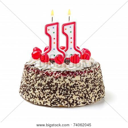 Birthday cake with burning candle number 11