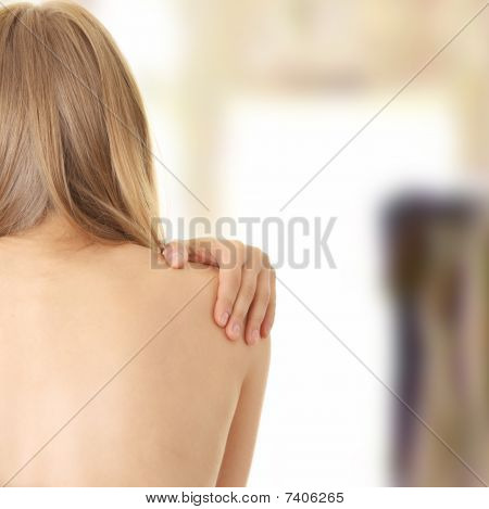 Pain In Her Back