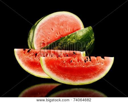 Studio Shot Whole And Slice Of Watermelon Isolated Black