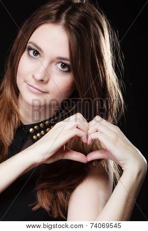 Teen Girl Doing Heart Shape Love Symbol With Hands