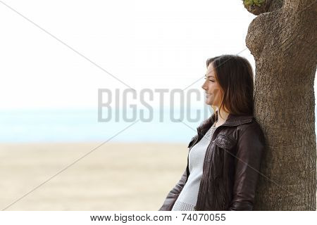 Pensive Woman Thinking On The Beach In Winter