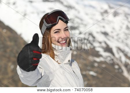 Positive Skier Woman Gesturing Thumb Up In Winter