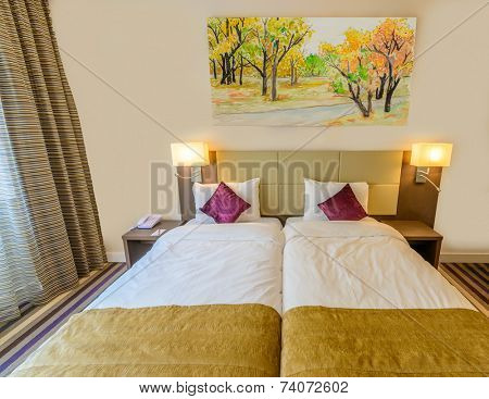 Modern brown yellow bedroom interior in a luxury house hotel resort