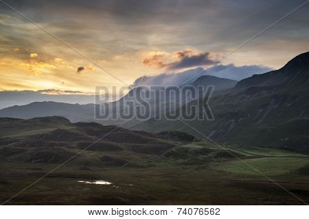 Stunning Sunrise Mountain Landscape With Vibrant Colors And Beautiful Cloud Formations
