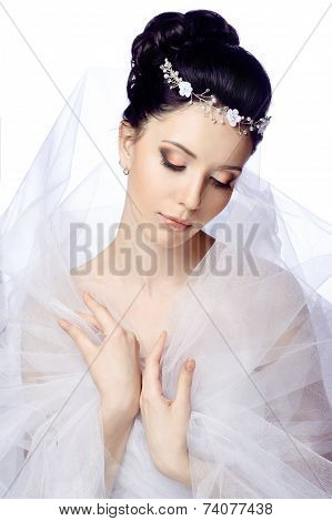 Modest young woman with closed eyes isolated on white studio background dressed in the cape of organ