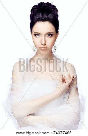 Young woman isolated on white studio background dressed in the cape of organza looking at camera