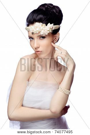 Young woman isolated on white studio background dressed in the cape of organza and beautiful tiara