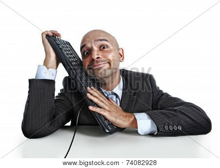 Businessman Caressing On Computer Keyboard With Funny Face Expre