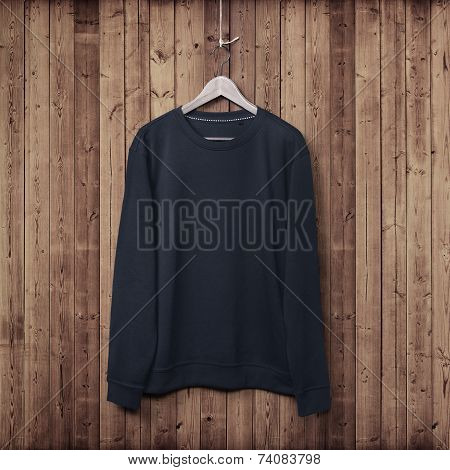 Sweater On A Wood Wall