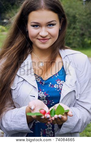 Beautiful Plump Girl Holding Crab Apples