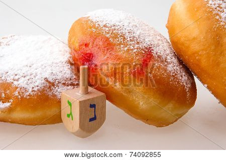 Hanukkah doughnut and spinning top