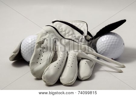 Golf glove, golf tees, and golf balls