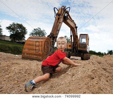 Boy And Escavator