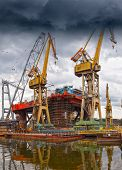 image of big-rig  - Big industrial crane on a dramatic sky background - JPG