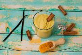 stock photo of cinnamon  - healthy smoothie with turmeric vanilla cinnamon and coconut milk