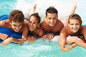 picture of 15 year old  - Group Of Teenage Friends Having Fun In Swimming Pool - JPG
