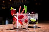 foto of mojito  - Two glasses of strawberry and grape mojitoes on marble table - JPG