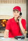 foto of take out pizza  - Delivery woman of pizza is taking orders by phone - JPG