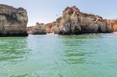 foto of lagos  - Rock formations near Lagos in Portugal seen from the water - JPG