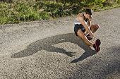 picture of stretching  - Runner man warming arms with sun light shadow warm up and stretching - JPG