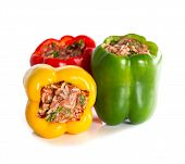 stock photo of ground-beef  - multicolor stuffed bell pepper filled with ground meat rice onion and parsley on white background - JPG