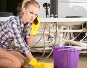 image of clog  - Woman mopping up - JPG