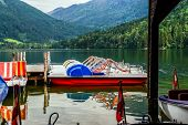 stock photo of pedal  - Pedal boats grouped together on the lake Austria - JPG