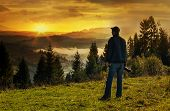 stock photo of asheville  - Man photographer in the mountains in autumn at sunset - JPG