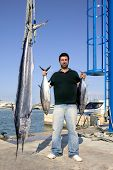 stock photo of spearfishing  - angler fish catch albacore tuna and spearfish mediterranean - JPG