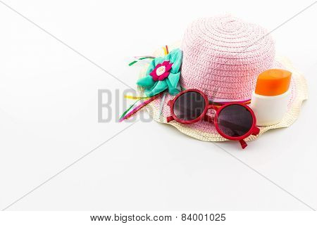 Pink Woven Hat With Body Lotion And Red Sunglasses.