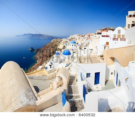Traditional White And Blue Village In Santorini