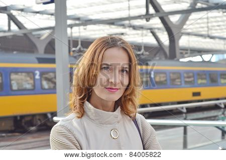 Closeup portrait of a young woman at a train station