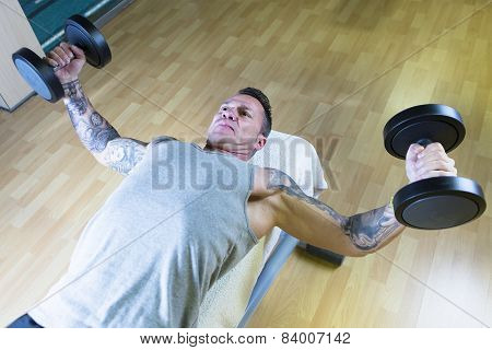 Man Making Dumbbell Fly - Workout Routine .